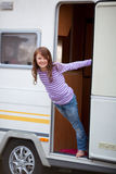 Playful Girl Standing At Caravan Entrance Stock Images