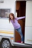 Playful Girl Standing At Caravan Entrance Stock Images