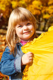 Playful girl with umbrella Royalty Free Stock Photos