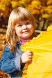 Playful girl with umbrella Royalty Free Stock Photos