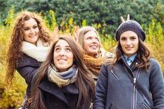 Playful girls, Four smiling girl Stock Photos