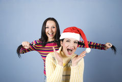 Playful Girls Pulling Pigtails Royalty Free Stock Photos
