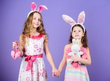 Playful girls sisters celebrate easter. Spring holiday. Happy childhood. Easter day. Easter activities for children. Happy easter. Holiday bunny girls with royalty free stock photos