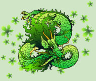 Playful green wood Asian dragon on leaves. Playful green wood Asian chinese dragon against green leaves Royalty Free Stock Photos