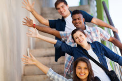 Playful group students. Playful group of cheerful teenage high school students Stock Image
