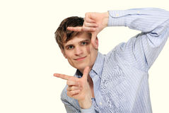 Playful guy finger frame Stock Images