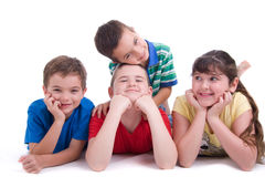 Playful happy kids. A studio view of four, happy, playful kids.  White background Stock Images