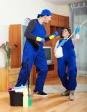 Playful housecleaners Royalty Free Stock Photography