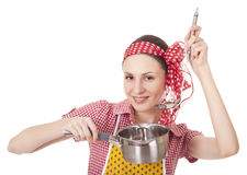 Playful housewife with ladle and pan Stock Image