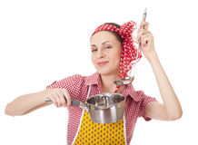 Playful housewife with ladle and pan Royalty Free Stock Images