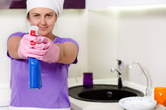 Playful housewife taking aim with the detergent Stock Photo