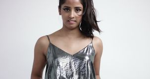 Playful Indian girl in cool metallic one piece suit stock footage