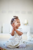 Playful infant. Portrait of a cute little girl having fun Stock Image