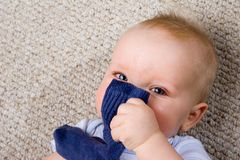 Playful infant with a sock Royalty Free Stock Images