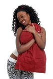 Playful jamaican woman hugging a pillow Stock Photography