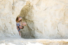 Playful jolly children look out from a small cave, Malta Stock Photo