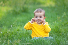 Playful kid pointing his ears Royalty Free Stock Photos