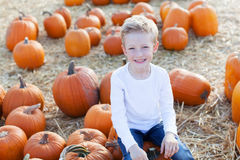 Playful kid with pumpkin Royalty Free Stock Photography