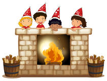 Playful kids at the fireplace Stock Photo