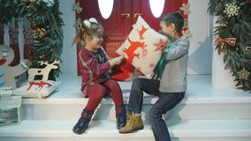 Playful kids having pillow fight. New year concept stock video