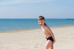 Playful kids on summer beach sand vacation having fun and happy time Royalty Free Stock Images