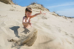 Playful kids on summer beach sand vacation having fun and happy time Royalty Free Stock Photo