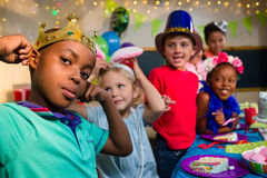 Playful kids at table Royalty Free Stock Photo