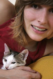 Playful kitten 5. Young girl with her playful kitten royalty free stock photo
