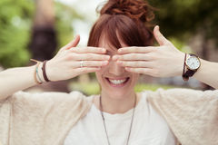 Playful Lady Covering her Eyes Using her Hands Royalty Free Stock Photography