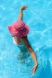 Playful lady in pool Stock Photo