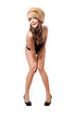Playful lady wearing swimsuit and fur-cap royalty free stock image