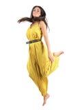 Playful Latino fashion beauty woman jumping bare feet Royalty Free Stock Image