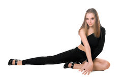 Playful leggy girl. Sitting in a black tight-fitting body suit dance Royalty Free Stock Photos