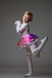 Playful little ballerina posing at camera Stock Photos
