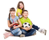 Playful little boy and girls sitting on the floor Stock Photos