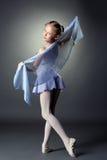 Playful little dancer posing at camera Stock Photo