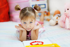 Playful little girl Stock Photo