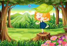 A playful little girl above the stump Royalty Free Stock Images