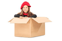 Playful little girl in carton box Royalty Free Stock Photos
