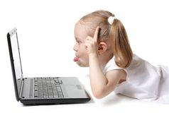 Playful little girl with a computer Stock Image