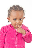 Playful little girl with a finger in her mouth Royalty Free Stock Photography