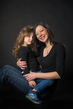 Playful little girl with her mom Stock Images
