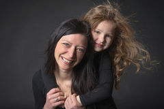 Playful little girl with her mom Royalty Free Stock Images
