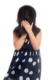 Playful little girl hiding face. With hair on white background Royalty Free Stock Photo