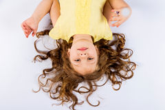 Playful Little Girl In Yellow Dress Barefoot Royalty Free Stock Images