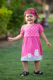 Playful little girl in the park. stock images