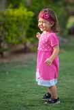 Playful little girl in the park. Playful little girl in the park, she is ready to play and smiling stock photography