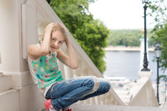 Playful little girl playing on a flight of steps Royalty Free Stock Photo