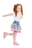 Playful little girl simulates flight. Playful little girl with hands raised simulates flight. Girl is six years old Royalty Free Stock Photography