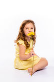 Playful little girl in yellow dress barefoot Royalty Free Stock Photography